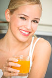 Woman with glass of juice. Indoors Stock Photos