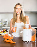 Woman with a glass of  juice Royalty Free Stock Photos
