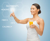 Woman with glass of juice and virtual screen Stock Photography