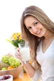 Woman with a glass of milk Stock Photography