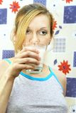 Woman with glass of milk Stock Photography