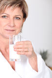 Woman with glass of milk Royalty Free Stock Images