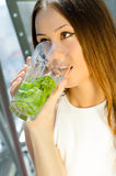 Woman with glass of mojito drink Stock Images