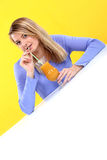 Woman with a glass of orange juice Royalty Free Stock Image
