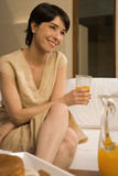 Woman with glass of orange juice Royalty Free Stock Photo