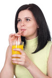 Woman with a glass of oranges juice Royalty Free Stock Images