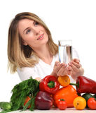 Woman with glass of pure drinking water and green vegetables Royalty Free Stock Photo