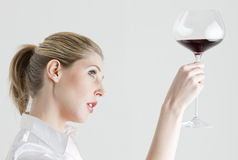 Woman with a glass of red wine Stock Photos