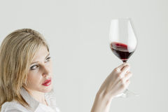 Woman with a glass of red wine Stock Image