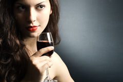 Woman with glass red wine Stock Image