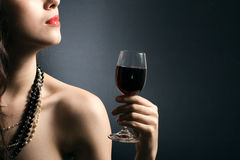 Woman with glass red wine Stock Photography