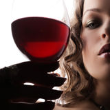Woman with glass red wine stock photos