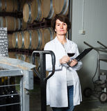 Woman with glass of red wine Stock Images