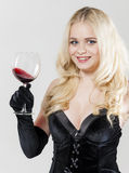 Woman with a glass of red wine Royalty Free Stock Photography
