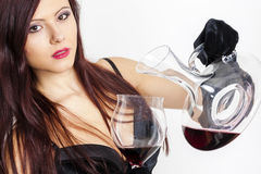 Woman with a glass of red wine Stock Images