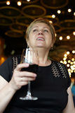 Woman with glass of red wine Royalty Free Stock Images