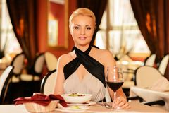 Woman with glass of red wine in restaurant Royalty Free Stock Photography