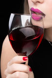 Woman with glass red wine. saturated color, nails. Royalty Free Stock Photos