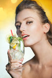 Woman with glass of refreshing cocktail Royalty Free Stock Photos