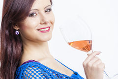 Woman with a glass of rose wine Stock Photos