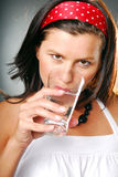 A woman with a glass of water Royalty Free Stock Image