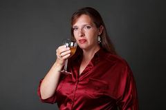 Woman with glass of white wine Stock Photos