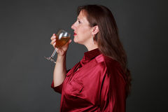 Woman with glass of white wine Royalty Free Stock Photography