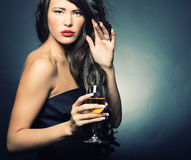 Woman with a glass of white wine Royalty Free Stock Image