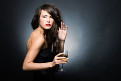 Woman with a glass of white wine Royalty Free Stock Photography