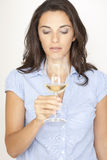 Woman with a glass of white wine Stock Image