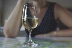 Glass of white wine. Woman with a Glass of white wine royalty free stock photo
