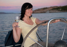 Woman with glass of wine. Young woman on the yacht with glass of wine stock photography