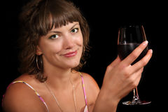 Woman with a glass of wine Stock Image