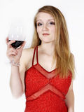 Woman with glass of wine. Attractive young woman with glass of wine; white studio background royalty free stock photo