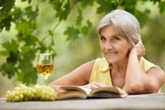 Woman with glass of wine Royalty Free Stock Photo