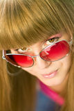 Woman in glasses. Young woman in pink glasses Royalty Free Stock Images