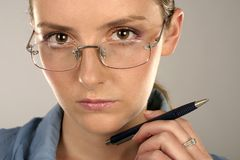 Woman in glasses. Young girl, woman in a blue blouse and glasses Stock Photography