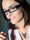 Woman in glasses. Blue pen Stock Photo