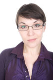 Woman with glasses. Young adult brunette woman with glasses over white background Royalty Free Stock Image