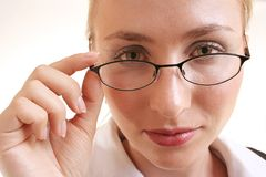 Woman with glasses. Looking over spactacles Stock Photos