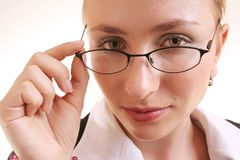 Woman with glasses. Woman looking over glasses Stock Images
