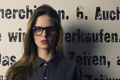 Skeptical woman with glasses. A nerd woman with glasses looking skeptical Royalty Free Stock Photography