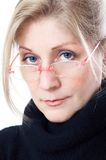 A woman with  glasses. Of a pink frame Royalty Free Stock Photography