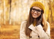 Woman with glasses and autumn clothes Stock Image