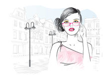 Woman in glasses on the background of the city. Vector illustration Royalty Free Stock Photos