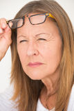 Woman with glasses and bad eyesight Royalty Free Stock Photo