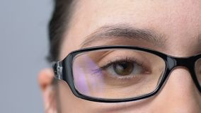 Woman in glasses blinking, tired of bad vision, eyesight problems, close-up stock video footage