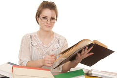 Woman in glasses and books look smile Stock Images