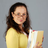 Woman in glasses with books Stock Photography
