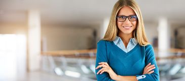 Woman with glasses in business center royalty free stock photo